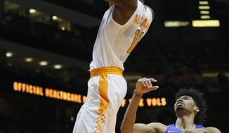 Tennessee forward Kyle Alexander (11) dunks in front of Kentucky forward Nick Richards (4) during the second half of an NCAA college basketball game Saturday, Jan. 6, 2018, in Knoxville, Tenn. (AP Photo/Crystal LoGiudice)