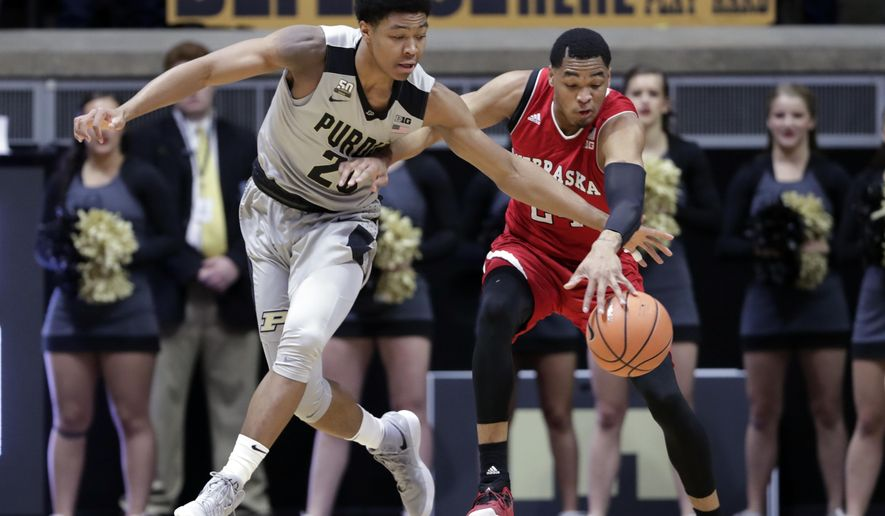 Purdue guard Nojel Eastern (20) and Nebraska guard James Palmer Jr. (24) go for a loose ball in the first half of an NCAA college basketball game in West Lafayette, Ind., Saturday, Jan. 6, 2018. (AP Photo/Michael Conroy)