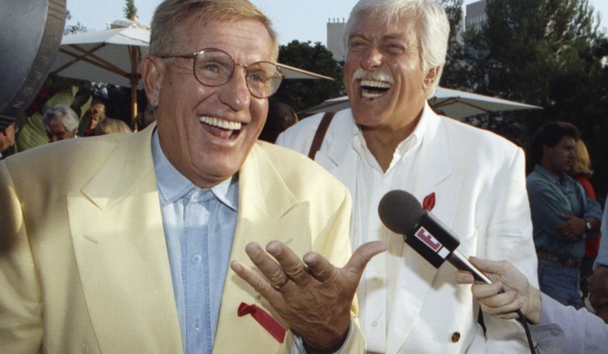 "In this Aug. 25, 1992, file photo, Jerry Van Dyke, left, and his brother, Dick, laugh during a party in Los Angeles. Jerry Van Dyke, ""Coach"" star and younger brother of comedian Dick Van Dyke, died in Arkansas at 86 on Jan. 5, 2018. His wife, Shirley Ann Jones, was by his side. (AP Photo/Chris Martinez, File)"
