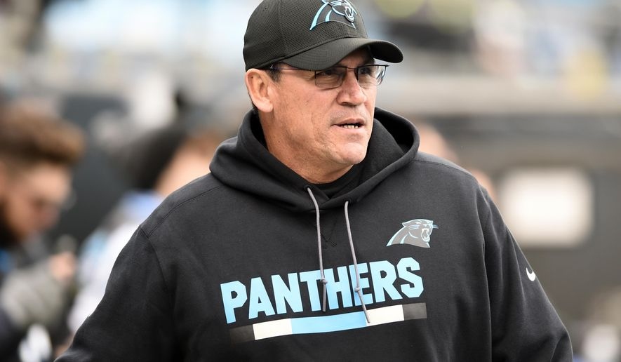FILE - This Dec. 17, 2017 file photo shows Carolina Panthers head coach Ron Rivera watching his team warm up before an NFL football game against the Green Bay Packers in Charlotte, N.C. Rivera has signed a two-year extension keeping him under contract through the 2020 season.The team announced the extension Saturday, Jan. 6, 2018. (AP Photo/Mike McCarn, file)