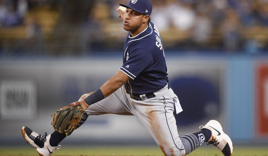 FILE - In this Sept. 25, 2017, file photo, San Diego Padres third baseman Yangervis Solarte holds on to the ball after catching a line drive hit by Los Angeles Dodgers' Cody Bellinger during the fifth inning of a baseball game in Los Angeles.  The Toronto Blue Jays acquired Solarte from the Padres on on Saturday, Jan 6, 2018,  for prospects Edward Olivares and Jared Carkuff. (AP Photo/Kelvin Kuo, File)