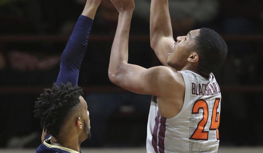Virginia Tech's Kerry Blackshear Jr. (24) shoots over Terrell Brown during the first half of an NCAA college basketball game in Blacksburg, Va. Saturday, Jan. 6 2018. (Matt Gentry/The Roanoke Times via AP)