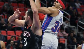 Detroit Pistons forward Tobias Harris (34) shoots over Houston Rockets forward Ryan Anderson (33) during the first half of an NBA basketball game, Saturday, Jan. 6, 2018, in Detroit. (AP Photo/Carlos Osorio)