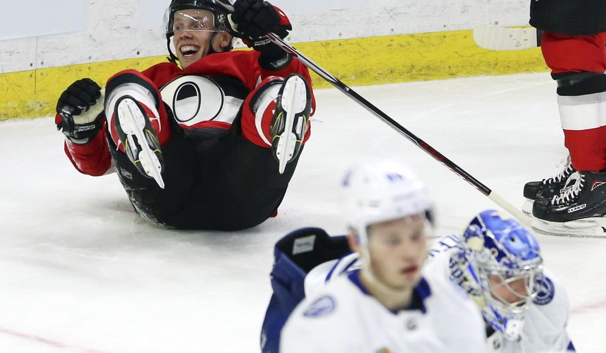 Ottawa Senators left wing Ryan Dzingel (18) celebrates his goal against the Tampa Bay Lightning during the third period of an NHL hockey game Saturday, Jan. 6, 2018, in Ottawa, Ontario. (Fred Chartrand/The Canadian Press via AP)