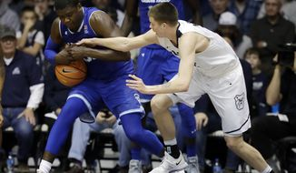 Seton Hall's Angel Delgado, left, grabs a loose ball against Butler's Sean McDermott during the second half of an NCAA college basketball game, Saturday, Jan. 6, 2018, in Indianapolis. Seton Hall won 90-87. (AP Photo/Darron Cummings)