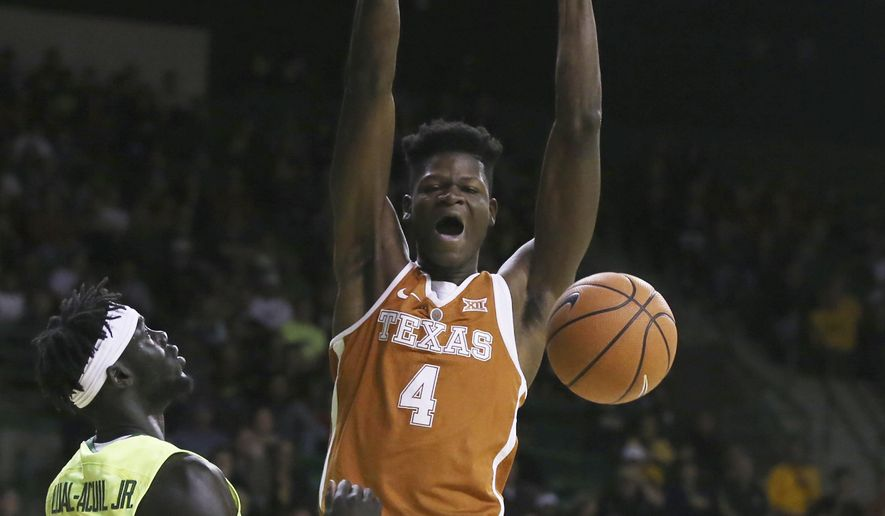 Texas forward Mohamed Bamba, right, scores over Baylor forward Jo Lual-Acuil Jr. , in the first half of an NCAA college basketball game, Saturday, Jan. 6, 2018, in Waco, Texas. (Rod Aydelotte/Waco Tribune Herald via AP)