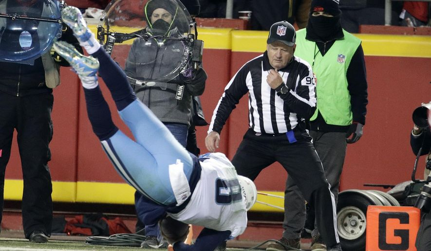 Tennessee Titans quarterback Marcus Mariota (8) leaps over the goal line for a touchdown in the second half of an NFL wild-card playoff football game against the Kansas City Chiefs in Kansas City, Mo., Saturday, Jan. 6, 2018. (AP Photo/Charlie Riedel)