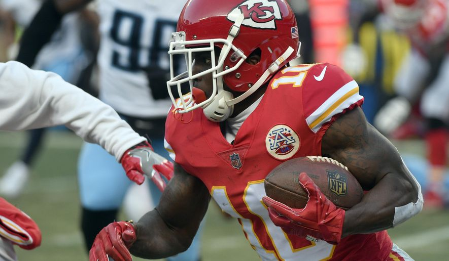 Kansas City Chiefs wide receiver Tyreek Hill (10) carries the ball during the first half of an NFL wild-card playoff football game against the Tennessee Titans, in Kansas City, Mo., Saturday, Jan. 6, 2018. (AP Photo/Ed Zurga)