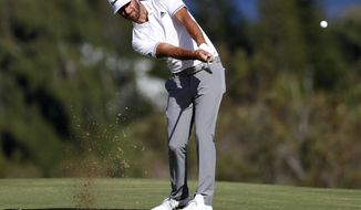 Dustin Johnson hits from the fourth fairway during the third round of the Tournament of Champions golf event, Saturday, Jan. 6, 2018, at Kapalua Plantation Course in Kapalua, Hawaii. (AP Photo/Matt York)
