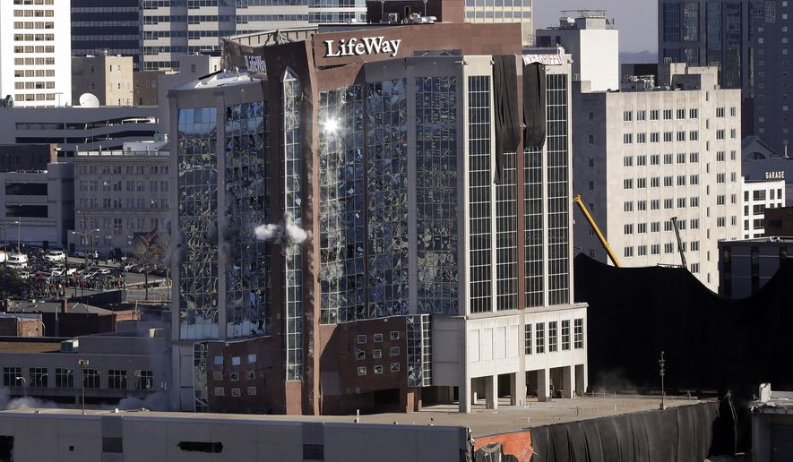 The 12-story tower that housed the former LifeWay Christian Resources facility is imploded Saturday, Jan. 6, 2018, in Nashville, Tenn. A billion dollar mixed-use development, called Nashville Yards, is planned to be built on the site. (AP Photo/Mark Humphrey)