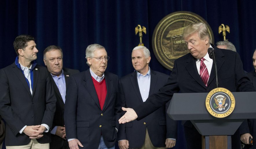 President Donald Trump, right, welcomes Senate Majority Leader Mitch McConnell of Ky., third from left, to the podium to speak during a news conference after participating in a Congressional Republican Leadership Retreat at Camp David, Md., Saturday, Jan. 6, 2018. Also pictured is House Speaker Paul Ryan of Wis., left, CIA Director Mike Pompeo, second from left, and Vice President Mike Pence, second from right. (AP Photo/Andrew Harnik)