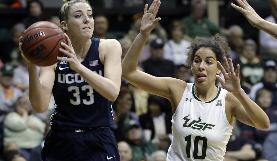 Connecticut guard/forward Katie Lou Samuelson (33) looks to pass the ball after getting around South Florida forward Laura Ferreira (10) during the first quarter of an NCAA college basketball game Saturday, Jan. 6, 2018, in Tampa, Fla. (AP Photo/Chris O'Meara)