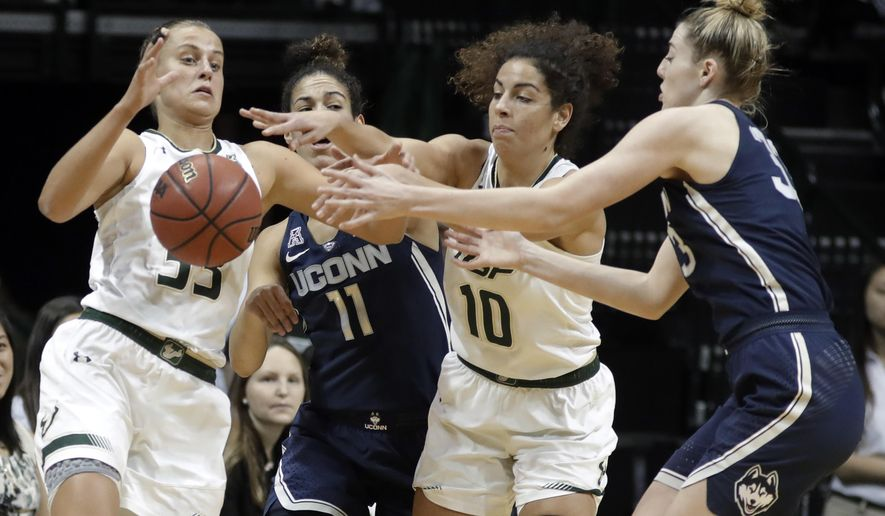 South Florida guard Kitija Laksa (33) and forward Laura Ferreira (10) battle with Connecticut guard Kia Nurse (11) and guard/forward Katie Lou Samuelson (33) for a loose ball during the first quarter of an NCAA college basketball game Saturday, Jan. 6, 2018, in Tampa, Fla. (AP Photo/Chris O'Meara)