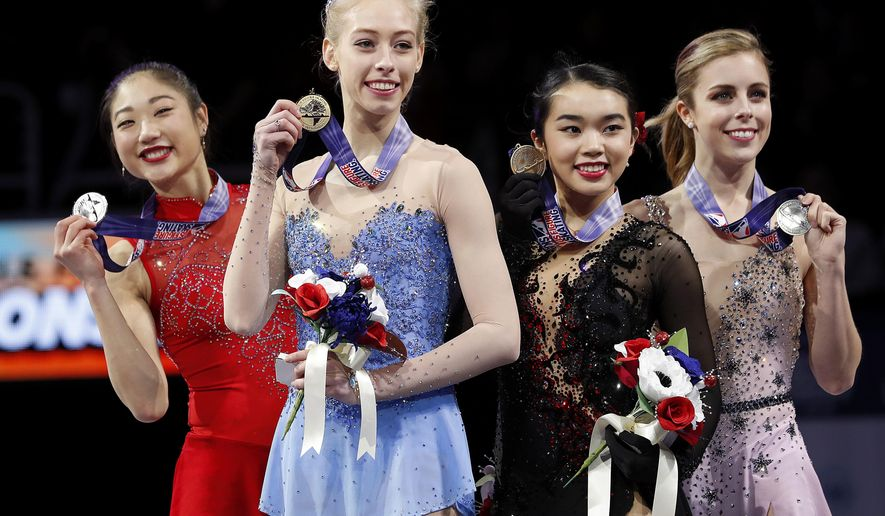 Bradie Tennell, foreground, poses after winning the women's free skate event with second place finisher Mirai Nagasu, left, third place finisher Karen Chen, second from right, and fourth place finisher Ashley Wagner at the U.S. Figure Skating Championships in San Jose, Calif., Friday, Jan. 5, 2018. (AP Photo/Tony Avelar)