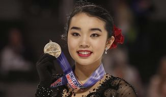 Karen Chen poses after finishing third at the women's free skate event at the U.S. Figure Skating Championships in San Jose, Calif., Friday, Jan. 5, 2018. (AP Photo/Tony Avelar) **FILE**