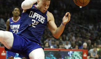 Los Angeles Clippers forward Blake Griffin (32) loses the ball while falling to the court during the first half of an NBA basketball game against the Golden State Warriors in Los Angeles, Saturday, Jan. 6, 2018. Griffin left and did not return to the game. (AP Photo/Alex Gallardo)