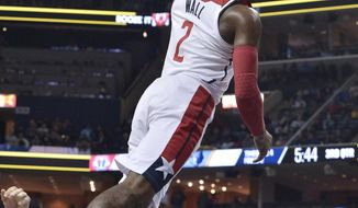 Washington Wizards guard John Wall goes up for a dunk during the second half of an NBA basketball game against the Memphis Grizzlies on Friday, Jan. 5, 2018, in Memphis, Tenn. (AP Photo/Brandon Dill)