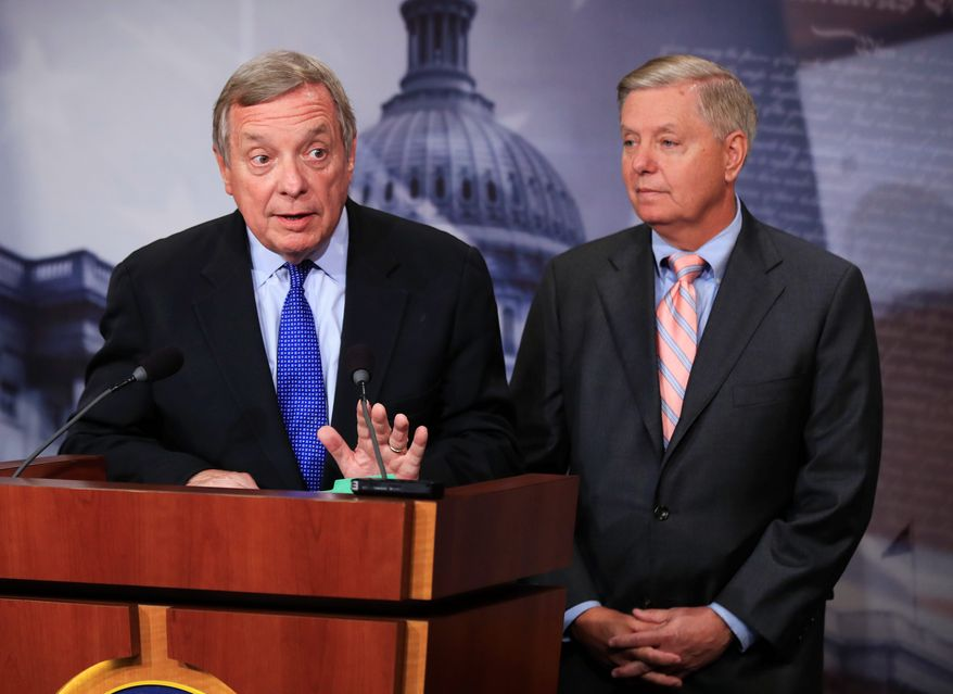 Sen. Richard J. Durbin, Illinois Democrat, is negotiating for a solution with Sen. Lindsey Graham, a South Carolina Republican who has been among his party's most liberal members on immigration. (Associated Press/File)