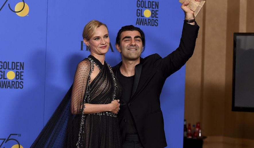 "Diane Kruger, left, and Fatih Akin poses in the press room with the award for best motion picture - foreign language for ""In The Fade"" at the 75th annual Golden Globe Awards at the Beverly Hilton Hotel on Sunday, Jan. 7, 2018, in Beverly Hills, Calif. (Photo by Jordan Strauss/Invision/AP)"