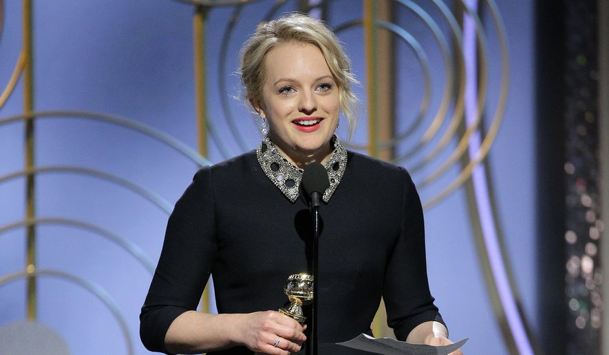 "This image released by NBC shows Elisabeth Moss accepting the award for best actress in a drama series for her role in ""The Handmaid's Tale,"" at the 75th Annual Golden Globe Awards in Beverly Hills, Calif., on Sunday, Jan. 7, 2018. (Paul Drinkwater/NBC via AP)"