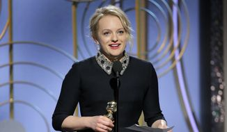 """This image released by NBC shows Elisabeth Moss accepting the award for best actress in a drama series for her role in """"The Handmaid's Tale,"""" at the 75th Annual Golden Globe Awards in Beverly Hills, Calif., on Sunday, Jan. 7, 2018. (Paul Drinkwater/NBC via AP)"""