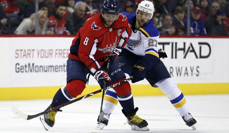 Washington Capitals left wing Alex Ovechkin (8), from Russia, controls the puck as St. Louis Blues defenseman Alex Pietrangelo (27) defends in the first period of an NHL hockey game, Sunday, Jan. 7, 2018, in Washington. (AP Photo/Alex Brandon)