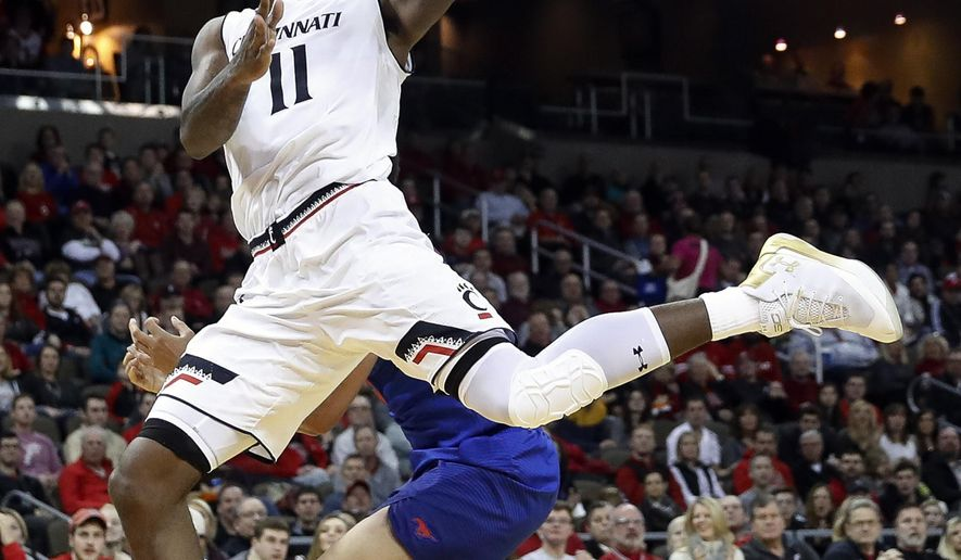 Cincinnati's Gary Clark (11) shoots in the first half of an NCAA college basketball game against SMU, Sunday, Jan. 7, 2018, in Highland Heights, Ky. (AP Photo/John Minchillo)
