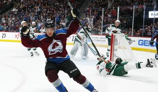 Colorado Avalanche center Tyson Jost celebrates after scoring a goal against the Minnesota Wild during the third period of an NHL hockey game Saturday, Jan. 6, 2018, in Denver. The Avalanche won 7-2. (AP Photo/David Zalubowski)