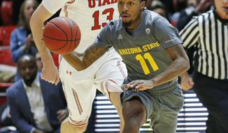 Arizona State guard Shannon Evans II (11) brings the ball up court as Utah forward David Collette (13) looks on in the first half during an NCAA college basketball game Sunday, Jan. 7, 2018, in Salt Lake City. (AP Photo/Rick Bowmer)