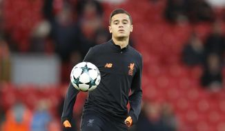 FILE - In this file photo dated Wednesday, Sept. 13, 2017, Liverpool's Philippe Coutinho during a warm up prior to the Champions League soccer match between Liverpool and Sevilla at Anfield stadium in Liverpool, England.  Coutinho arrives at Barcelona soccer club Sunday Jan. 7, 2018, signed from Liverpool for a huge price tag and expected to continue the long line of Brazilian stars who have dazzled at Camp Nou. (AP Photo/Frank Augstein, FILE)