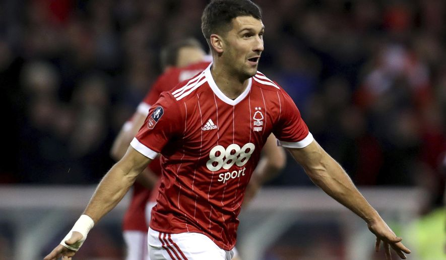 Nottingham Forest's Eric Lichaj celebrates scoring his side's first goal of the game during the English FA Cup, Third Round soccer match between Nottingham Forest and Arsenal at the City Ground, Nottingham, England, Sunday, Jan. 7, 2018. (Mike Egerton/PA via AP)