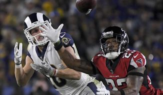 Atlanta Falcons cornerback Robert Alford, right, breaks up a pass intended for Los Angeles Rams wide receiver Cooper Kupp during the second half of an NFL football wild-card playoff game Saturday, Jan. 6, 2018, in Los Angeles. (AP Photo/Mark J. Terrill)