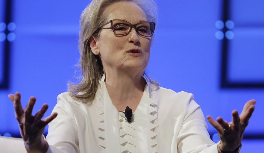 FILE - In this Thursday, Dec. 7, 2017, file photo, Academy Award-winning actress Meryl Streep speaks during the annual Massachusetts Conference for Women, in Boston. Streep, Michelle Williams, Emma Stone, Emma Watson and Amy Poehler are just a few of the actresses who are planning to bring gender and racial justice activists as their guests to the Golden Globe Awards, Sunday, Jan. 7, 2018. Streep will attend with Ai-jen Poo, the director of the National Domestic Workers Alliance. (AP Photo/Steven Senne, File)