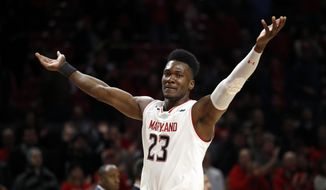 Maryland forward Bruno Fernando, of Angola, gestures to fans in the final moments of an NCAA college basketball game against Iowa in College Park, Md., Sunday, Jan. 7, 2018. Maryland won 91-73. Fernando contributed a team-high 21 points to Maryland's 91-73 win. (AP Photo/Patrick Semansky) **FILE**