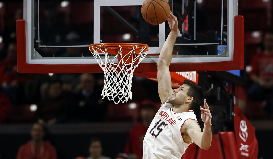Maryland center Michal Cekovsky, of Slovakia, scores a basket in the first half of an NCAA college basketball game against Iowa in College Park, Md., Sunday, Jan. 7, 2018. (AP Photo/Patrick Semansky)