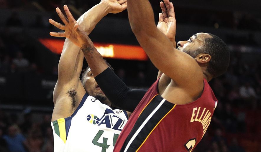 Miami Heat guard Wayne Ellington (2) goes to the basket against Utah Jazz guard Donovan Mitchell (45) during the first half of an NBA basketball game, Sunday, Jan. 7, 2018, in Miami. (AP Photo/Joel Auerbach)