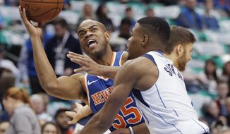 New York Knicks guard Jarrett Jack (55) battles Dallas Mavericks guard Dennis Smith Jr. (1) for space during the first half of an NBA basketball game Sunday, Jan. 7, 2018, in Dallas. (AP Photo/Brandon Wade)