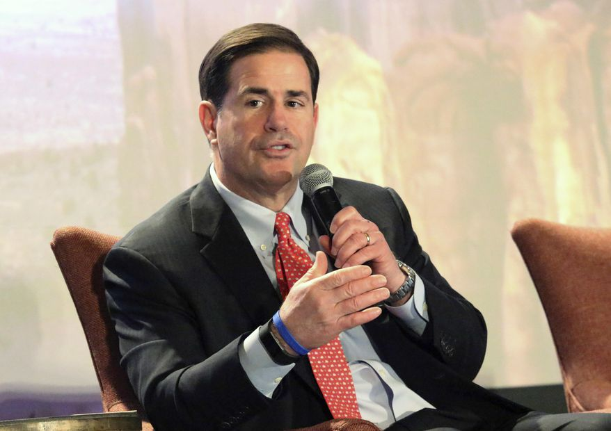 Arizona Gov. Doug Ducey addresses business leaders and lawmakers at the Arizona Chamber of Commerce's annual legislative forecast luncheon in Phoenix, Friday, Jan. 5, 2018. Arizona Gov. Doug Ducey promised more help for the state's underfunded K-12 schools at a business group's legislative forecast lunch, while also touting the amount of money he's worked to inject into the system in the past three years. (AP Photo/Bob Christie)
