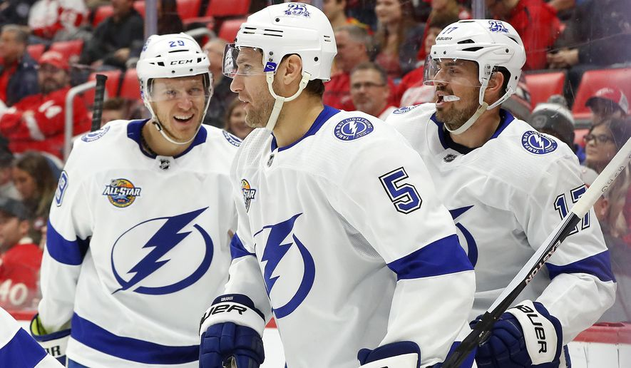 Tampa Bay Lightning defenseman Dan Girardi (5) celebrates his goal against the Detroit Red Wings with J.T. Brown, left, and Alex Killorn, right, in the first period of an NHL hockey game Sunday, Jan. 7, 2018, in Detroit. (AP Photo/Paul Sancya)