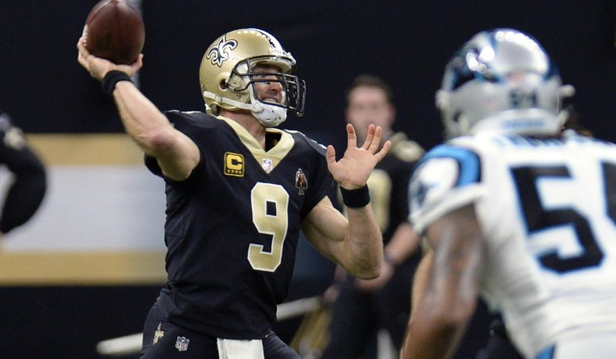 New Orleans Saints quarterback Drew Brees (9) passes in the first half of an NFL football game against the Carolina Panthers in New Orleans, Sunday, Jan. 7, 2018. (AP Photo/Bill Feig)