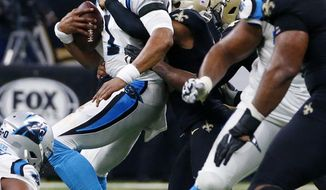 Carolina Panthers quarterback Cam Newton (1) is sacked on forth down late in the second half of an NFL football game against the New Orleans Saints in New Orleans, Sunday, Jan. 7, 2018. The Saints won 36-21. (AP Photo/Butch Dill)