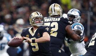 New Orleans Saints quarterback Drew Brees (9) passes in the first half of an NFL football game against the Carolina Panthers in New Orleans, Sunday, Jan. 7, 2018. (AP Photo/Butch Dill)