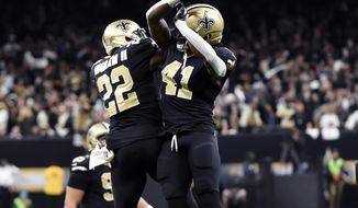 New Orleans Saints running back Alvin Kamara (41) celebrates his touchdown carry with running back Mark Ingram (22) in the second half of an NFL football game against the Carolina Panthers in New Orleans, Sunday, Jan. 7, 2018. (AP Photo/Bill Feig)