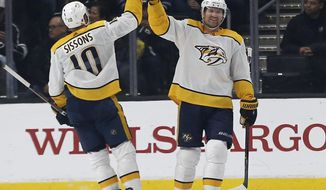 Nashville Predators left wing Scott Hartnell, right, celebrates his goal against the Los Angeles Kings with center Colton Sissons during the second period of an NHL hockey game in Los Angeles, Saturday, Jan. 6, 2018. (AP Photo/Alex Gallardo)