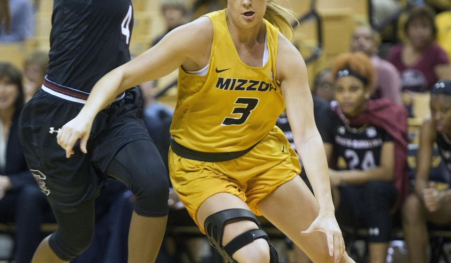 Missouri's Sophie Cunningham, right, dribbles around South Carolina's Doniyah Cliney, left, during the first half of an NCAA college basketball game Sunday, Jan. 7, 2018, in Columbia, Mo. (AP Photo/L.G. Patterson)