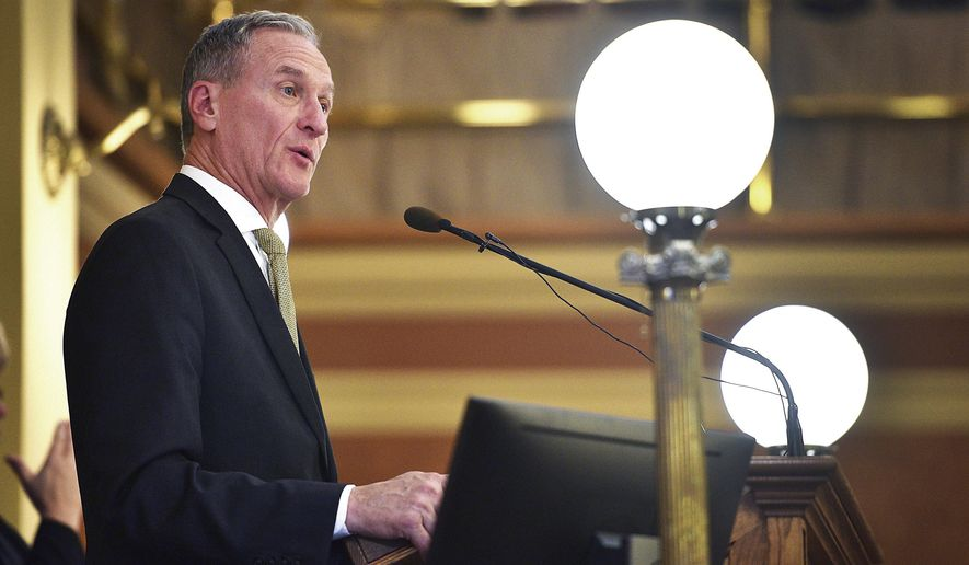 FILE - In this Dec. 5, 2017 file photo, South Dakota Gov. Dennis Daugaard outlines the state's spending priorities during his annual budget address at the State Capitol in Pierre, S.D. Daugaard's final legislative session as governor beginning Tuesday, Jan. 9, 2018, won't be full of new state spending, but South Dakota lawmakers will keep busy debating issues including legislator pay and the state's ballot question system. (Briana Sanchez/The Argus Leader via AP, File)