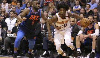 Phoenix Suns forward Josh Jackson (20) drives on Oklahoma City Thunder guard Raymond Felton in the second half during an NBA basketball game, Sunday, Jan. 7, 2018, in Phoenix. The Suns defeated the Thunder 114-100. (AP Photo/Rick Scuteri)