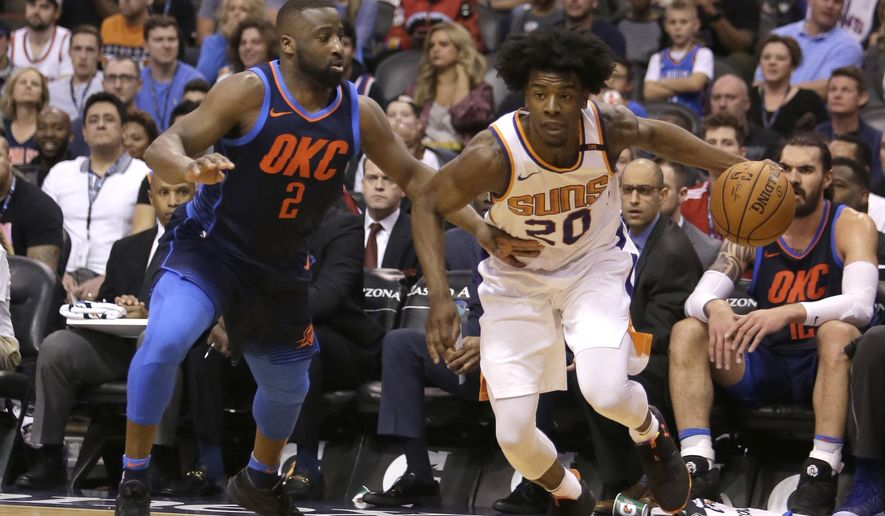 Phoenix Suns forward Josh Jackson (20) drives on Oklahoma City Thunder guard Raymond Felton in the second half during an NBA basketball game, Sunday, Jan. 7, 2018, in Phoenix. The Suns defeated the Thunder 114-100. (AP Photo/Rick Scuteri)