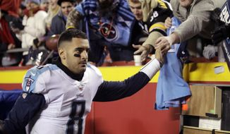 Tennessee Titans quarterback Marcus Mariota (8) greets fans following an NFL wild-card playoff football game against Kansas City Chiefs in Kansas City, Mo., Saturday, Jan. 6, 2018. (AP Photo/Orlin Wagner)
