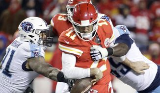Tennessee Titans defensive end David King (95) and linebacker Derrick Morgan (91) sack Kansas City Chiefs quarterback Alex Smith (11) during the second half of an NFL wild-card playoff football game, in Kansas City, Mo., Saturday, Jan. 6, 2018. (AP Photo/Charlie Riedel)